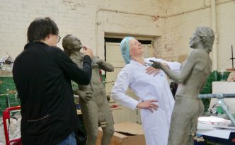 Hazel sculpts Sandra in the Housecoat uniform