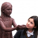 Emily with the sculpture of Sadako in progress - by Hazel Reeves