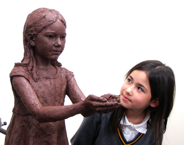 Emily with the sculpture of Sadako in progress