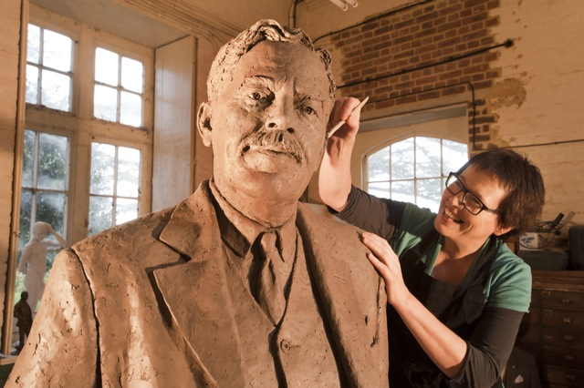 Image of Hazel Reeves sculpting the monumental Sir Nigel Gresley in her studio (photo by Roger Bamber)