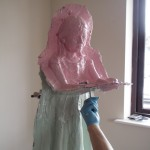 The rubber being applied to Sadako - sculpture by Hazel Reeves