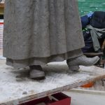 Long apron, underskirt and ankle-boots