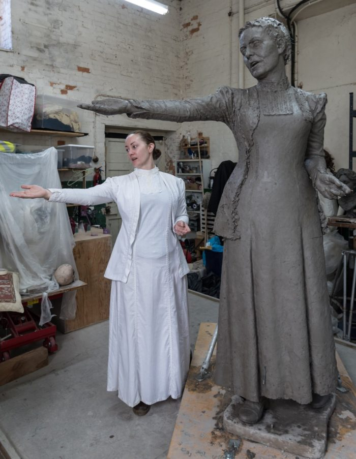 Sarah Jenkins with the Emmeline Pankhurst statue - photo by Nigel Kingston