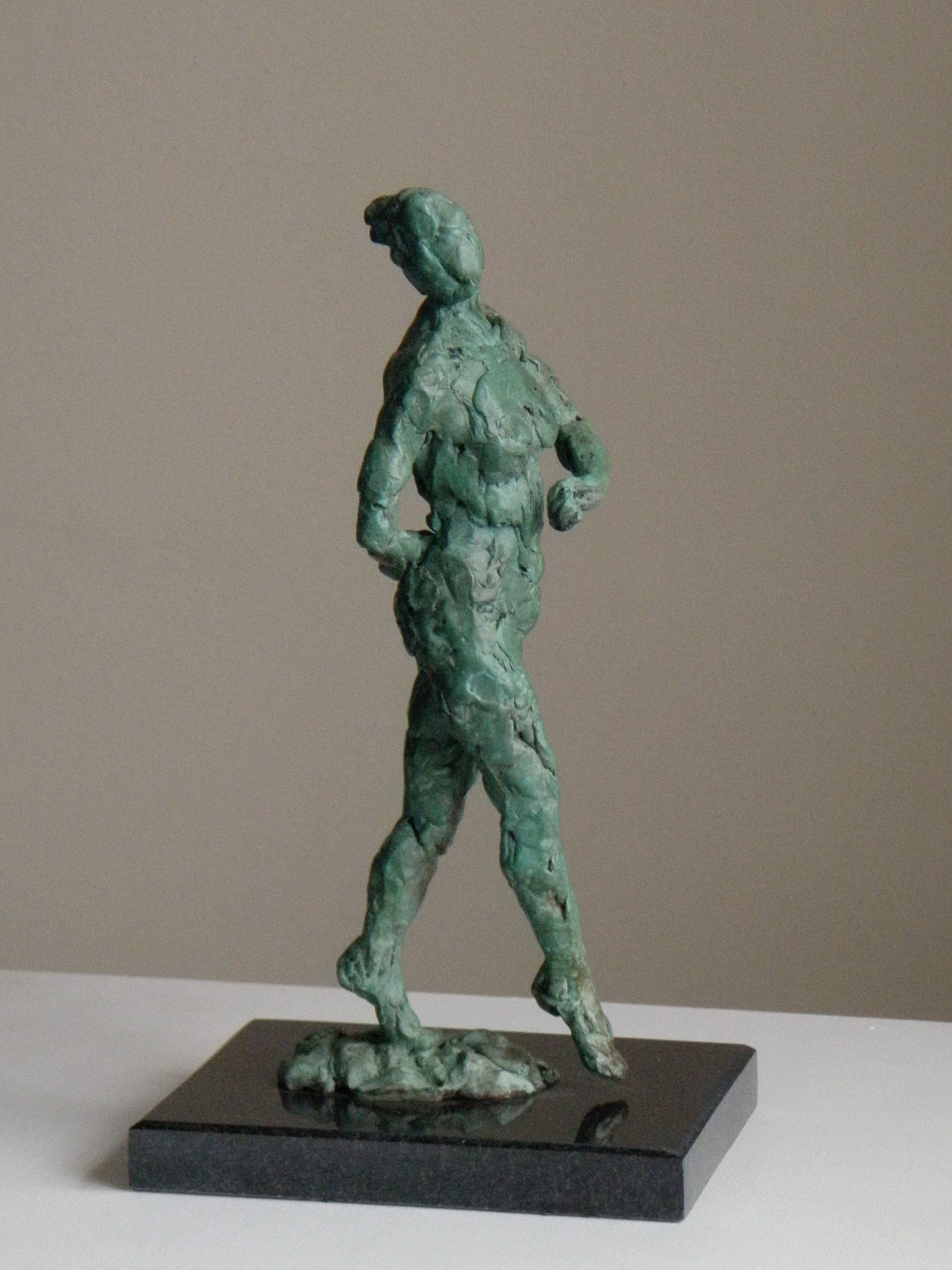 Photo of bronze dancing figure in verdigris