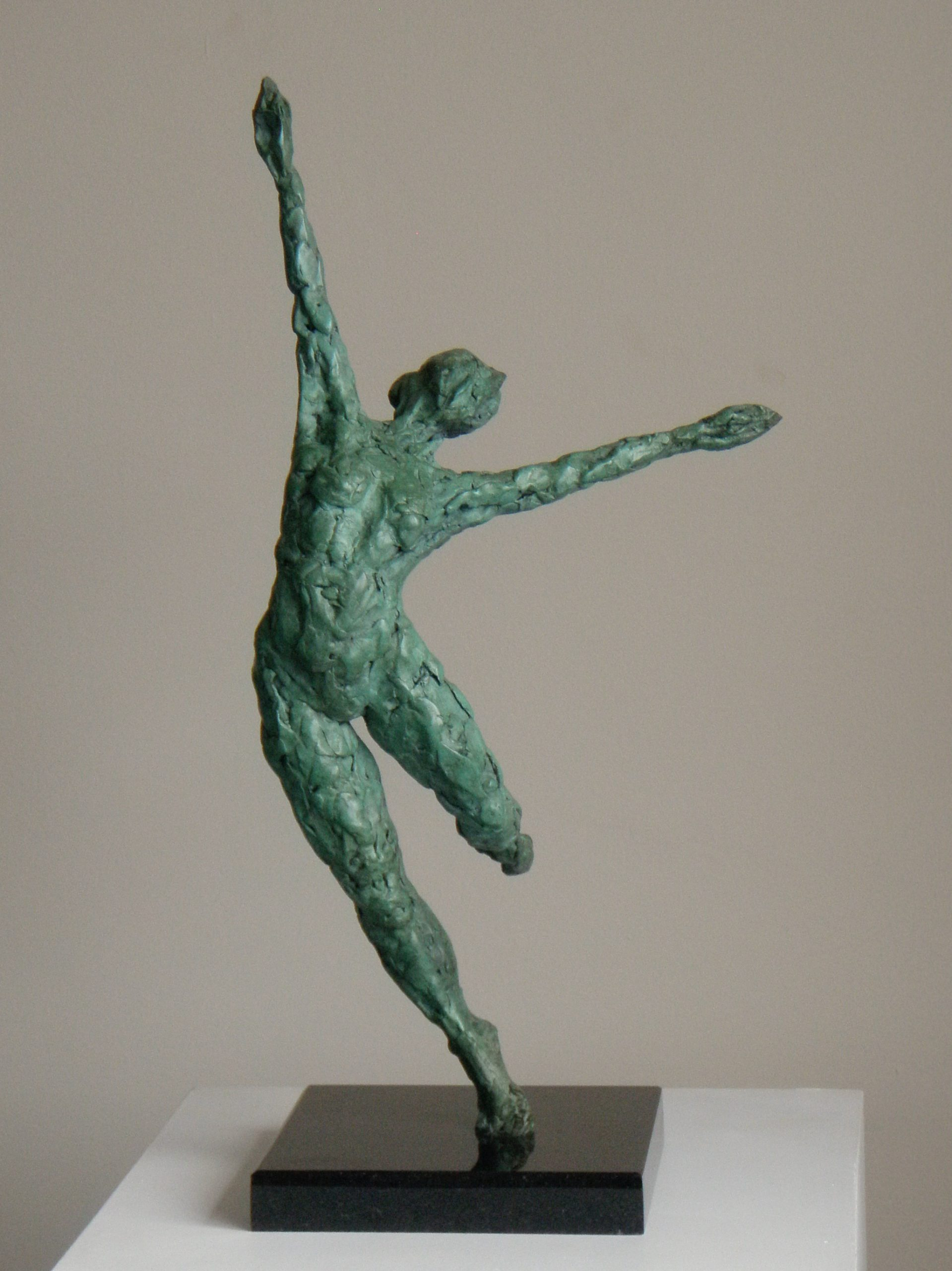 Photo of the verdigris bronze dancing figure called Dance V by Hazel Reeves