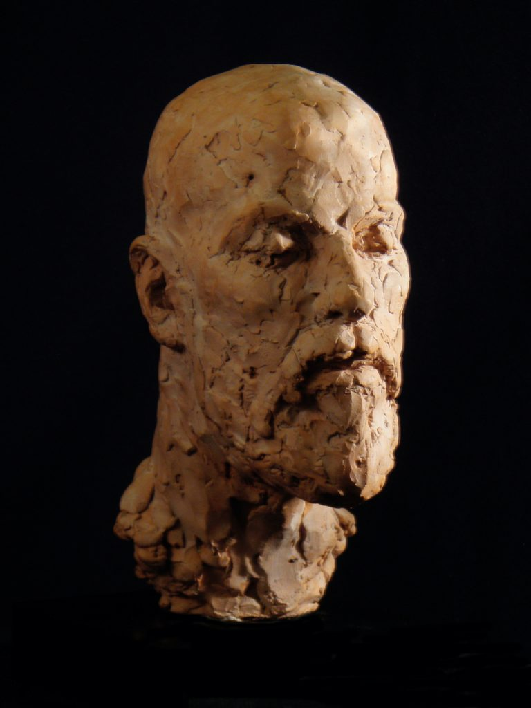 Fired clay sculpture of Daniel Marcus Clarke, with his eyes closed