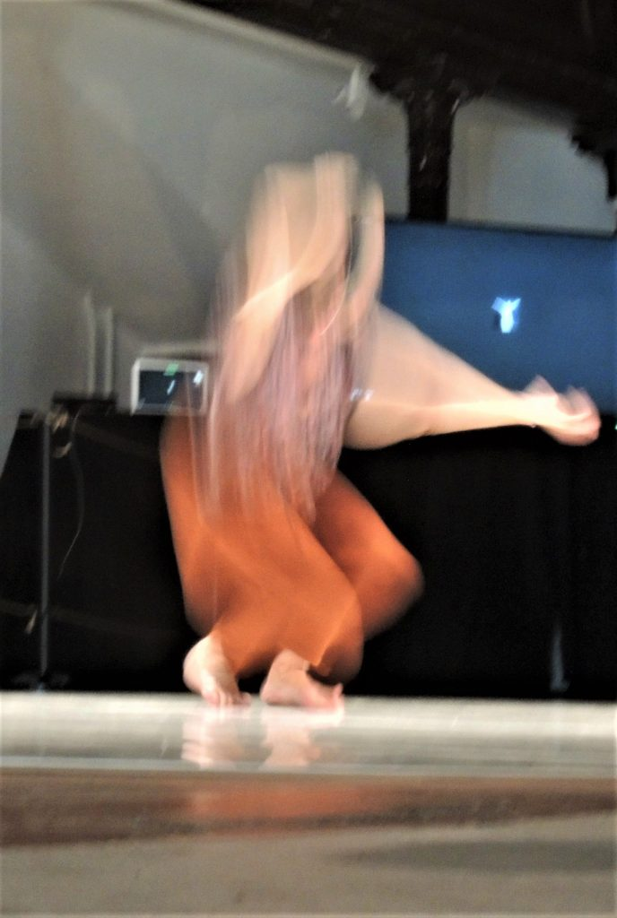 Image of dancer blurred by movement